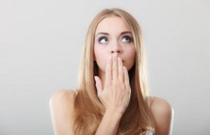 Woman Holding Hand Over Mouth Due to Bad Breath Fort Mill SC